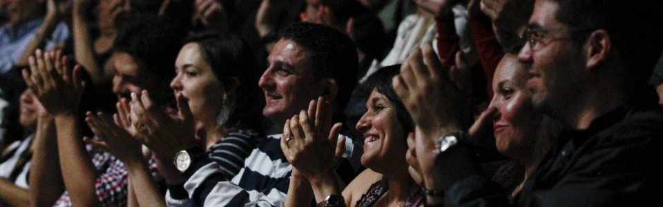 The audience claps during Venezuelan comedian Laureano Marquez's stand up performance in Caracas